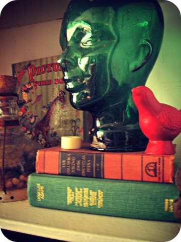Glass head and vintage books.